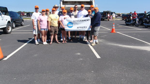 The AANR contingent helps clean up the beach.